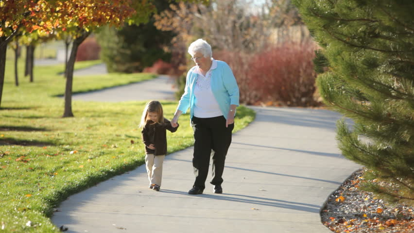 Grandmother and granddaughter in the park