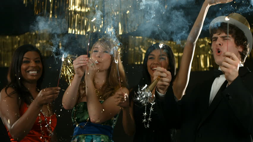 Group of people at New Year's party with sparklers | Shutterstock HD Video #4655447
