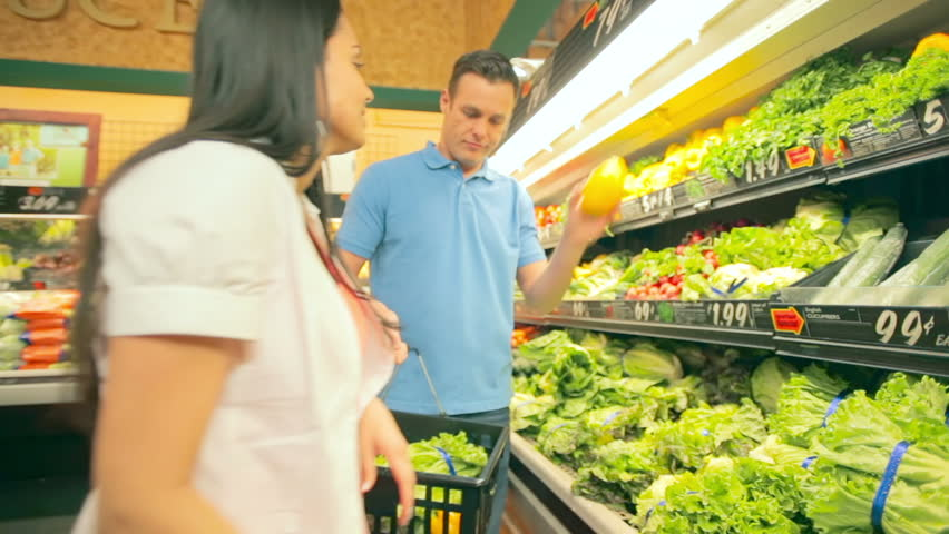 A couple have a little fight while shopping in the produce section of a grocery store. Medium shot. | Shutterstock HD Video #4655612