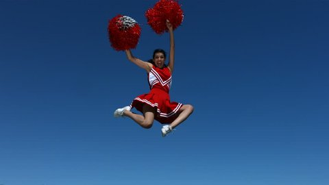 Cheerleader flies into the air, slow motion