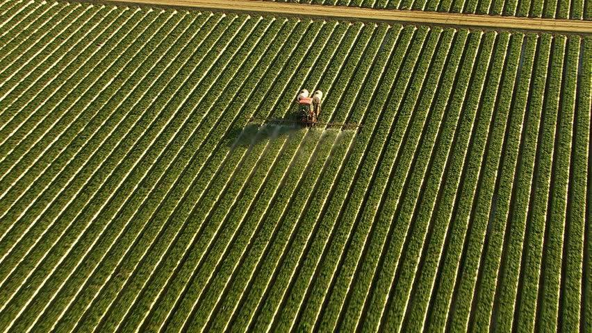 Aerial shot of tractor spraying field | Shutterstock HD Video #4658534