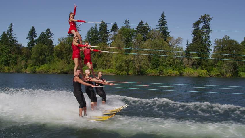 Stunt water skiers form human pyramid