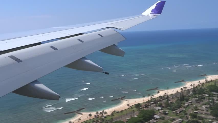 Airplane landing at Honolulu International Airport in Oahu.