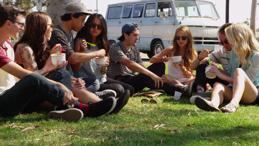 Group of young people hanging out at park