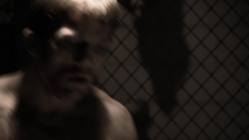 Mixed martial arts athlete warms up by shadow boxing.