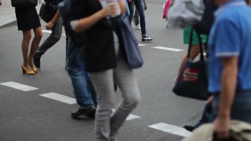 Time-lapse of casual dress people walk on crossroad city daytime
