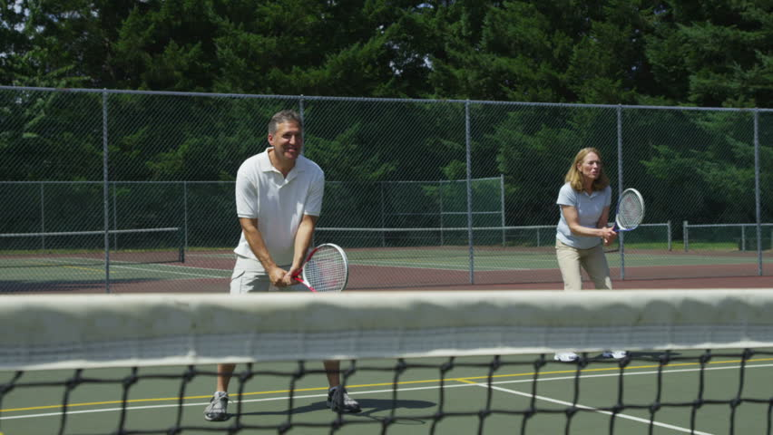 Mature couple playing tennis