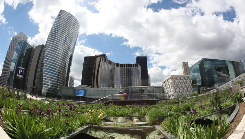 PARIS - MAY 11:  Paris skyline: The Grand Arch and Skyscrapers in the business district of La Defense  in Paris on May 11, 2013 | Shutterstock HD Video #4702241