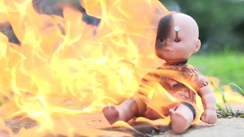 Baby doll with gasoline burning