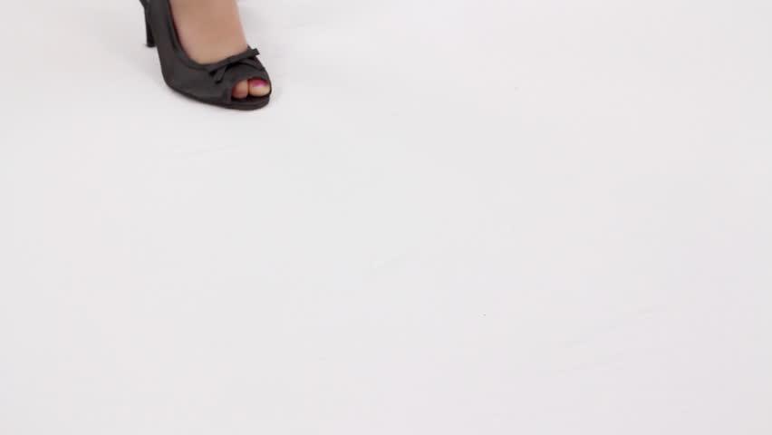 Little girl on a high heels