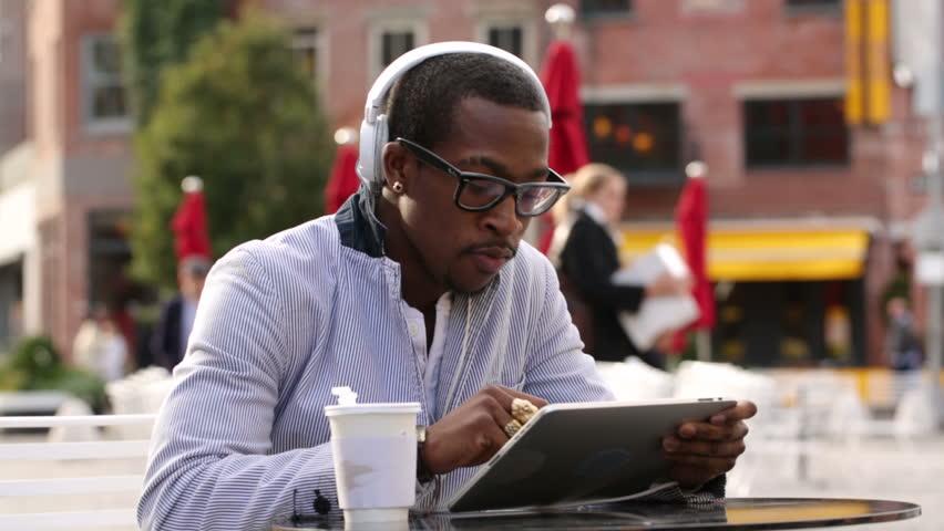 Man using tablet in public