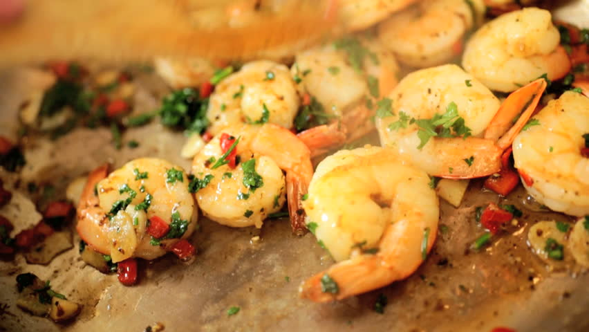 Low fat shrimp pan fry with chopped vegetables and herbs close up
