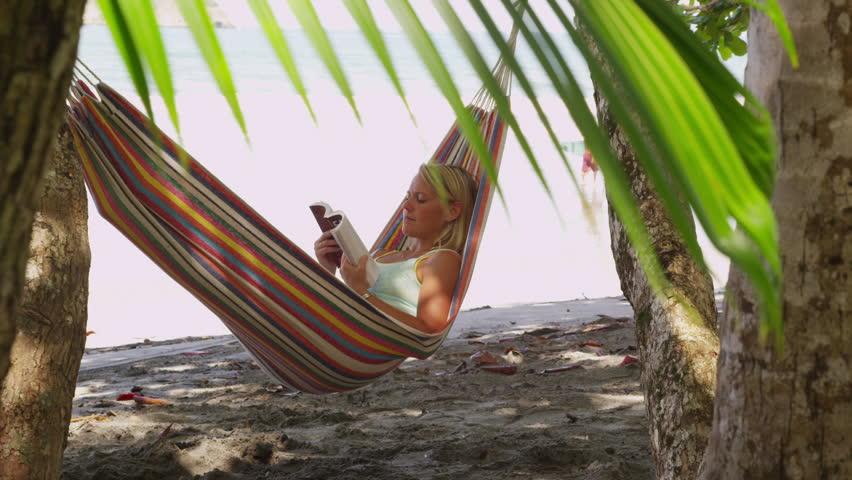 woman sitting in hammock reading book costa rica   hd stock video clip woman sitting in hammock reading book costa rica  shot on red      rh   shutterstock
