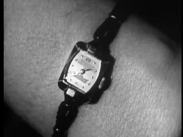 Close-up of woman's wrist watch