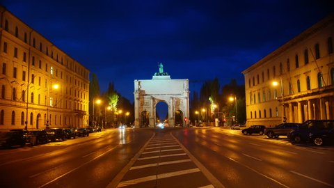Siegestor triumphal arch in Munich, Germany at night , time lapse