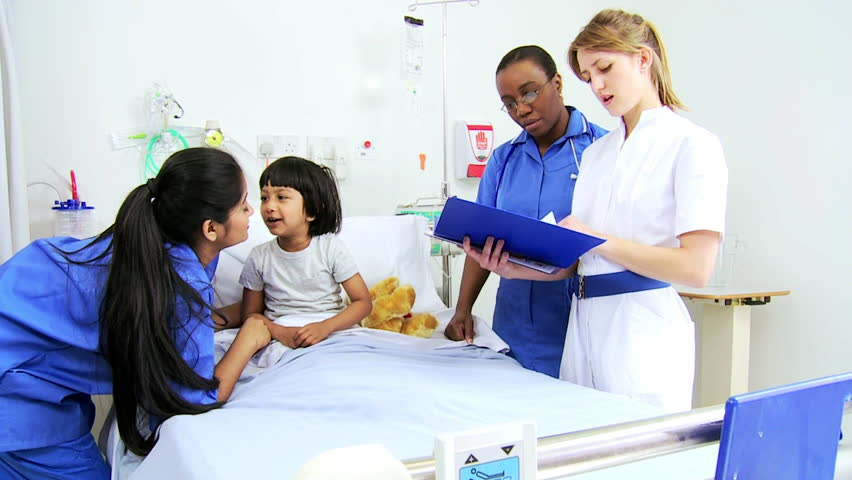 Pediatric Nursing Staff Checking Medical Charts Young Female Child