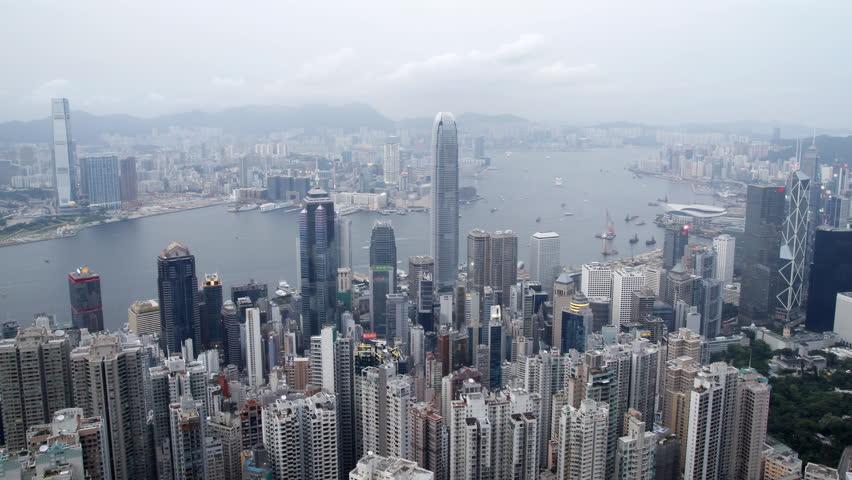 Hong Kong and Kowloon skyline day to night - 4K