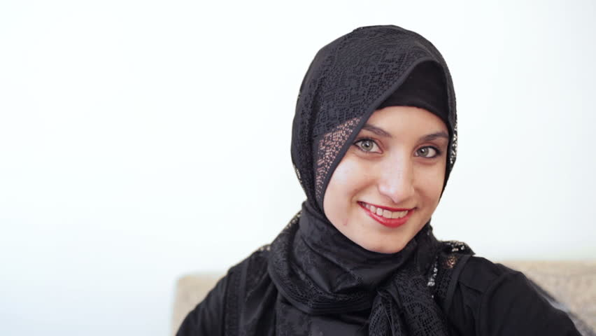 Headshot of young millenial teenage muslim girl with grey eyes a hijab headscarf and red lipstick smiling | Shutterstock HD Video #4786853