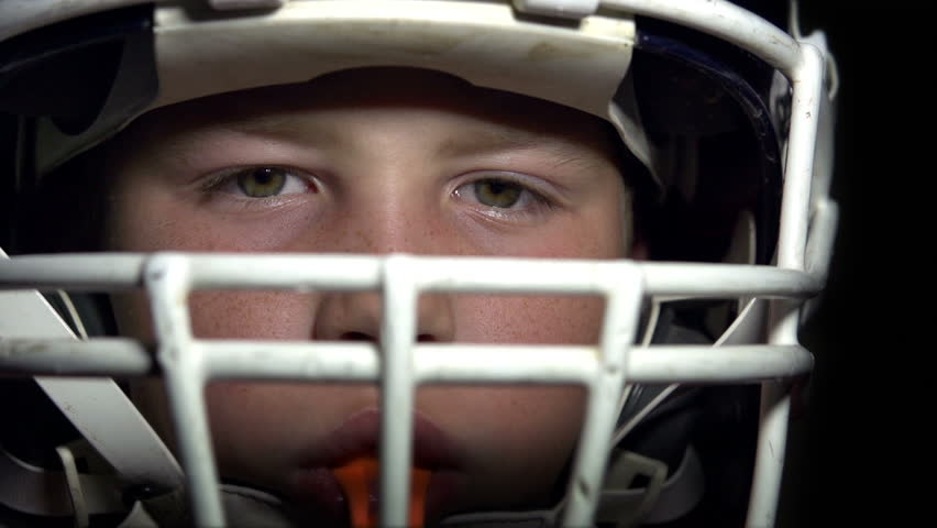 Boy in Football gear looking at camera,slow motion