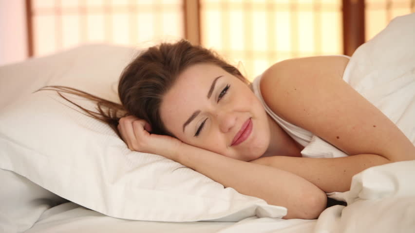 Cute Girl Sleeping In Bed Turning Around Opening Her Eyes And Smiling At  Camera Stock Footage Video 4812224 | Shutterstock