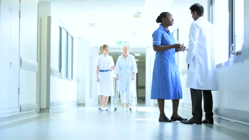 Medical staff supervising elderly female patient in physical therapy with walking frame | Shutterstock HD Video #4820744