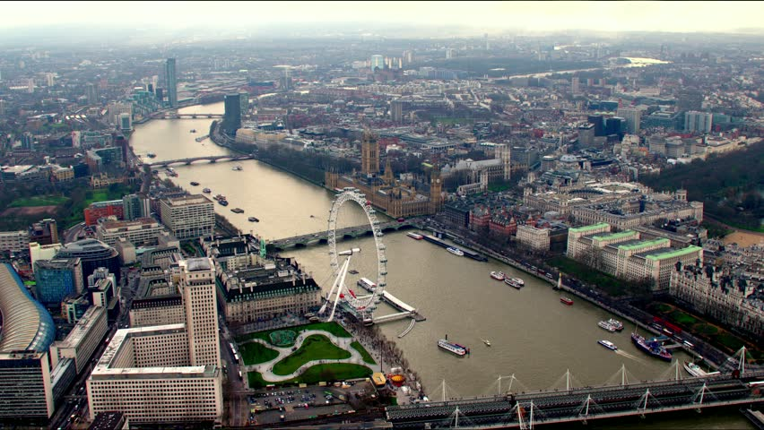 Aerial panorama of central London, UK. Features the River Thames, Millennium Wheel (London Eye), Waterloo and Houses of Parliament. | Shutterstock HD Video #4835774