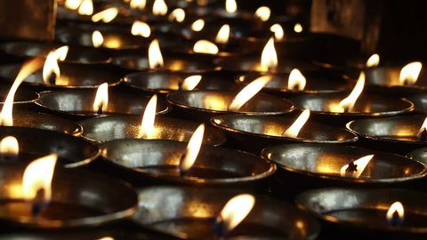 Candles burning in a Buddhist Temple at the ancient Swayambhunath complex, aka Monkey Temple, in Kathmandu, Nepal.
