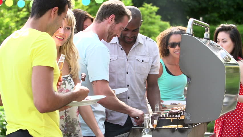 Dinner Party Video Part - 16: ... Men Serving Burgers, Kabobs, And Corn From Backyard Barbecue For  Summertime Dinner Party ...