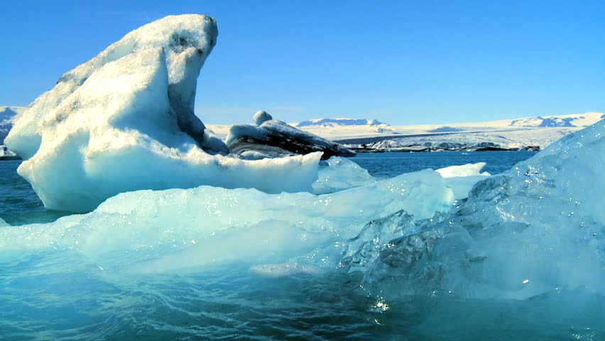 Glacial ice slowly melting into the lake through global warming 60 FPS