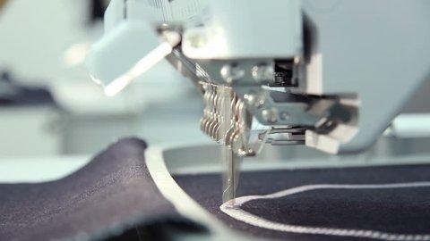 Computerized embroidery machine, women working