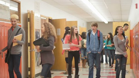 Classroom doors open and students walk out to the hallway