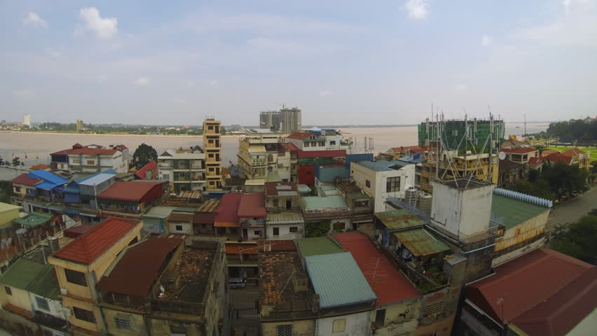 Panning timelapse of Phnom Penh capital and largest city of Cambodia with rooftop view of the Mekong river
