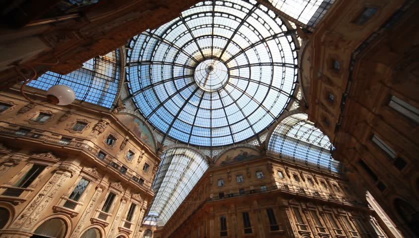 MILAN, ITALY - MAY 2: Unique view of Galleria Vittorio Emanuele II seen from above in Milan on august 6, 2013. Built in 1875 this gallery is one of the most popular shopping areas in Milan.