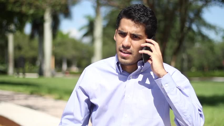 Angry businessman talking on the phone.Upset businessman