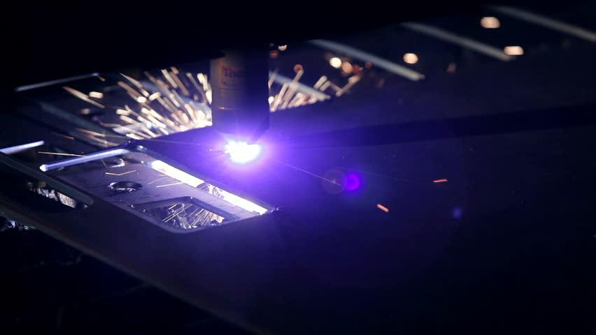 Laser cuts a piece of sheet steel   Shutterstock HD Video #4905134
