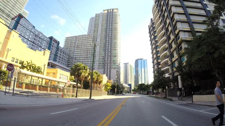 MIAMI - OCTOBER 11: Drivers pov vehicle driving along the streets of Brickell Miami October 11, 2013 in Miami, USA. Brickell is Miami's major financial district.  | Shutterstock HD Video #4905254