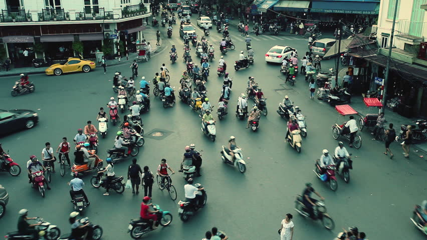 HANOI - SEPTEMBER 17: Timelapse view of crazy traffic in Hanoi Hoan Kiem district (old quarter) on September 17 2013 in Hanoi, Vietnam. No Identifiable person can be seen in the scene.