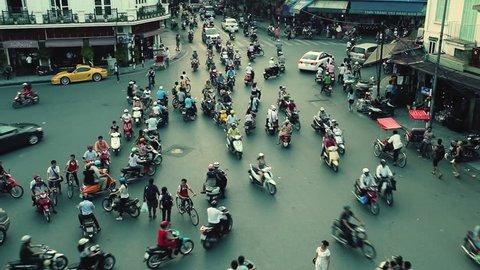 HANOI - SEPTEMBER 17: Timelapse view of crazy traffic in Hanoi Hoan Kiem district (old quarter) on September 17 2013 in Hanoi, Vietnam. No Identifiable person can be seen in the scene.