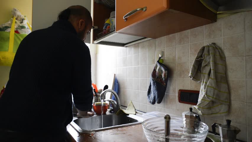Bearded man house husband washing dishes in the kitchen | Shutterstock HD Video #4916594
