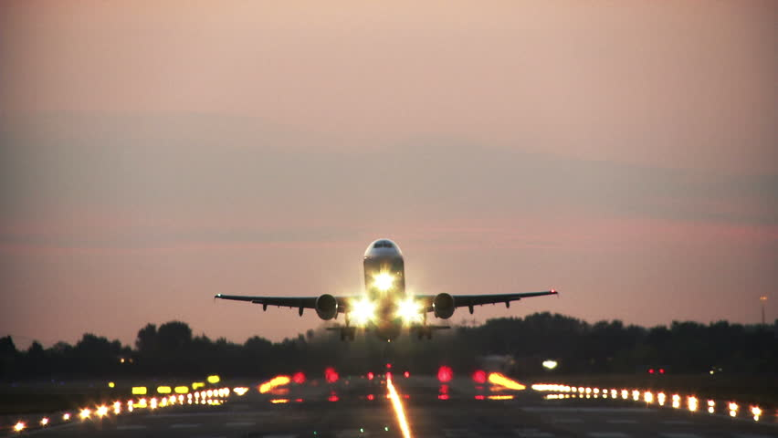 Jet plane take off at dusk