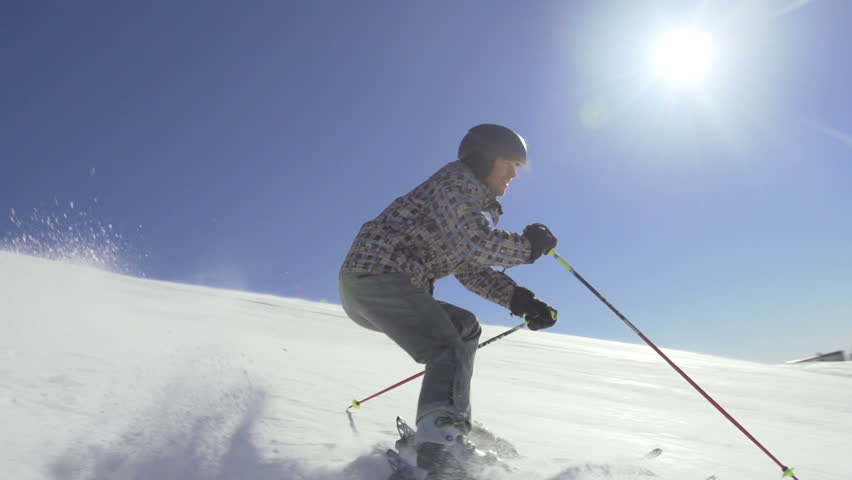 Slow Motion Of Back-Country Skier Skiing Down The Snowy Slope On A Sunny Winter