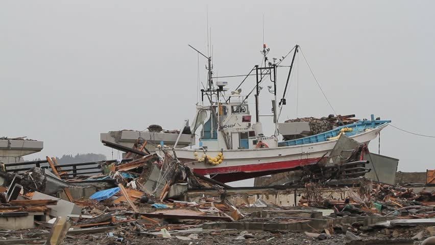 Wide of large stranded boat post-tsunami Japan