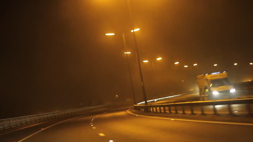 Car Driving Down Highway during Foggy Night - POV Point of View