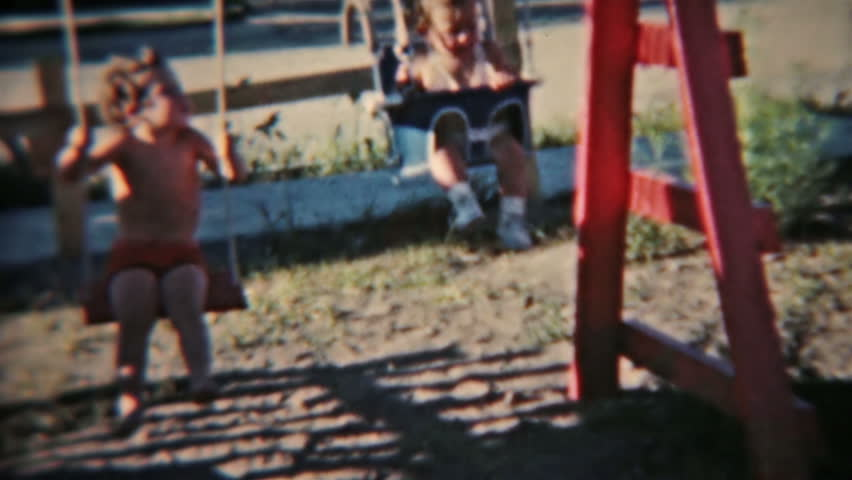 USA CIRCA 1940: Vintage lifestyle 8mm film homemade in 1940. Historical record young boy and baby swing set. Activities and fun growing up and playing. Color retro video family life in the 1940's.
