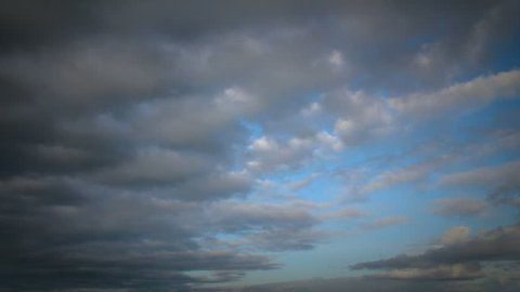 Transition from day through night. Fast moving clouds to star filled night sky