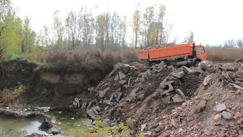 Truck dumping building waste on the landfill,wide angle. #4987559
