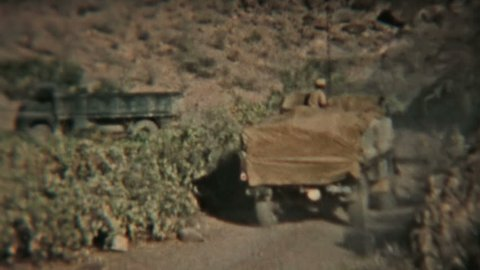ADEN PROTECTORATE - CIRCA 1960: Army truck convoy in the British Aden Protectorate, southern Arabia. Vintage 8mm footage. Today territory is the Republic of Yemen.