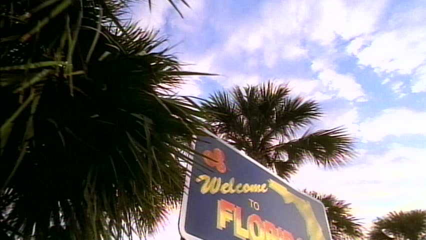 Tracking shot left to right of Welcome to Florida sign