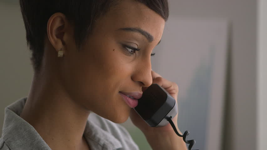 Close up of Black business woman making phone call