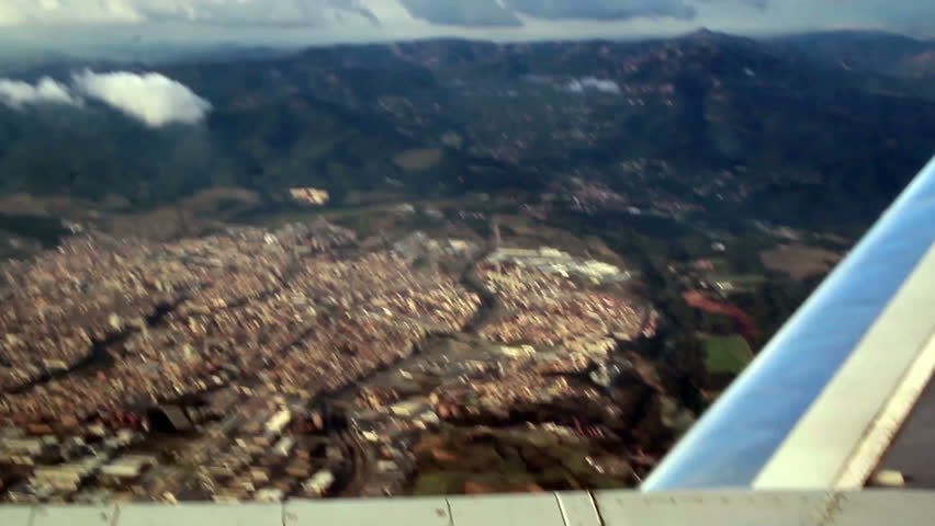 Aerial view of a certain city view from a plane. If you want to have a view like this you should sit beside the window.